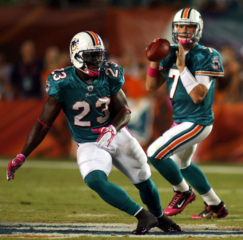 MIAMI - OCTOBER 04:  Running back Ronnie Brown #23 and Quarterback Chad Henne #7 of the Miami Dolphins runs against the New England Patriots at Sun Life Stadium on October 4, 2010 in Miami, Florida.  (Photo by Marc Serota/Getty Images)