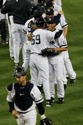NEW YORK - OCTOBER 09:  Mariano Rivera #42 of the New York Yankees celebrates with his teammates after their 6-1 win against the Minnesota Twins during Game Three of the ALDS part of the 2010 MLB Playoffs at Yankee Stadium on October 9, 2010 in the Bronx