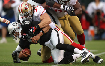 OAKLAND, CA - AUGUST 28:  Jason Campbell #8 of the Oakland Raiders is sacked by Travis LaBoy #54 of the San Francisco 49ers during an NFL preseason game at Oakland-Alameda County Coliseum on August 28, 2010 in Oakland, California. (Photo by Jed Jacobsohn/