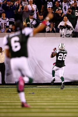 EAST RUTHERFORD, NJ - OCTOBER 11:  Quarterback Mark Sanchez of the New York Jets celebrates as Dwight Lowery #26 scores a 26-yard interception return for a touchdown in the fourth quarter against the Minnesota Vikings at New Meadowlands Stadium on October