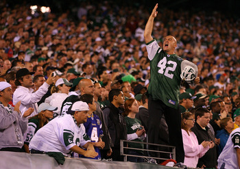 EAST RUTHERFORD, NJ - OCTOBER 11:  New York Jets fan Fireman Ed Anzalone leads the crowd in a cheer against the Minnesota Vikings at New Meadowlands Stadium on October 11, 2010 in East Rutherford, New Jersey.  (Photo by Andrew Burton/Getty Images)