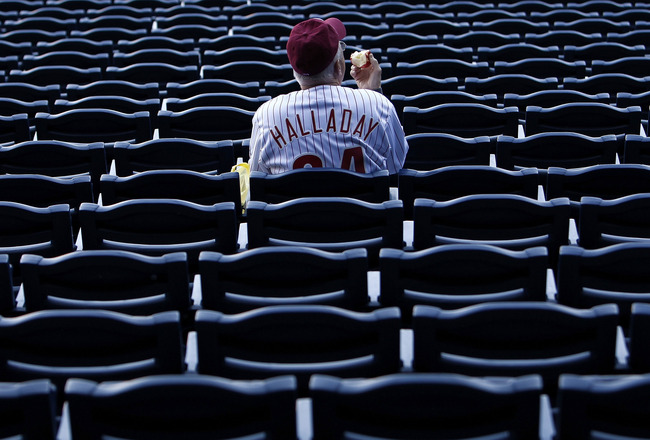 PHILADELPHIA - OCTOBER 08:  A fan wearing a Roy Halladay #34 of the Philadelphia Phillies jersey watches batting practice before Game 2 of the NLDS against the Cincinnati Reds at Citizens Bank Park on October 8, 2010 in Philadelphia, Pennsylvania.  (Photo
