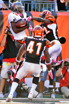 CINCINNATI, OH - OCTOBER 10:  Mike Williams #19 of the Tampa Bay Buccaneers makes a 20-yard touchdown reception as Johnathan Joseph #22 and Chinedum Ndukwe #41 of the Cincinnati Bengals defend at Paul Brown Stadium on October 10, 2010 in Cincinnati, Ohio.