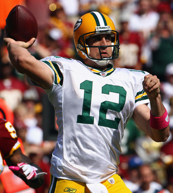 LANDOVER, MD - OCTOBER 10:  Quarterback Aaron Rodgers #12 of the Green Bay Packers throws a pass  against the Washington Redskins at FedExField on October 10, 2010 in Landover, Maryland. The Redskins won the game in overtime 16-13.  (Photo by Win McNamee/