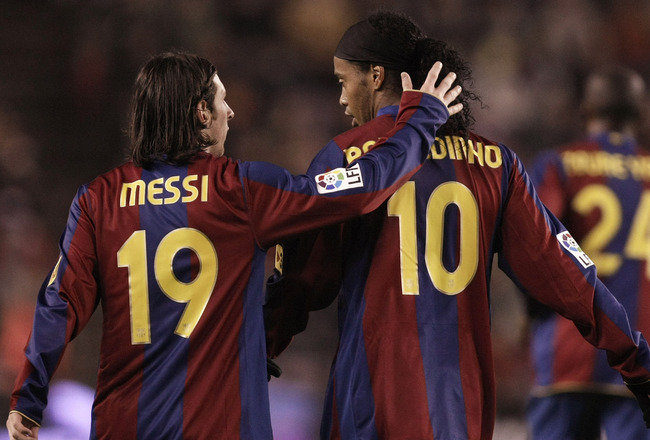 VALLADOLID, SPAIN - NOVEMBER 01:  Lionel Messi of Barcelona congratulates Ronaldinho after he scored Barcelona's first goal during the La Liga match between Valladolid and Barcelona at the Jose Sorillo stadium on November 1, 2007 in Valladolid, Spain.  (P