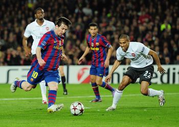 BARCELONA, SPAIN - APRIL 06:  Lionel Messi of Barcelona dribbles the ball before scoring his second goal during the UEFA Champions League quarter final second leg match between Barcelona and Arsenal at Camp Nou on April 6, 2010 in Barcelona, Spain.  (Phot