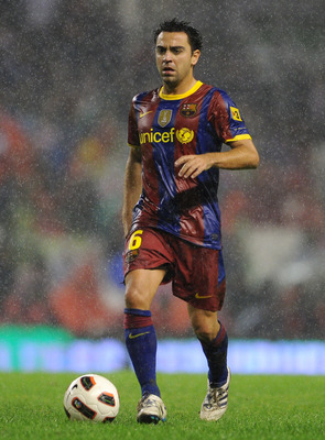 BILBAO, SPAIN - SEPTEMBER 25:  Xavi Hernandez of Barcelona runs with the ball during the La Liga match between Athletic Bilbao and Barcelona at the San Mames Stadium on September 25, 2010 in Bilbao, Spain. Barcelona won the match 3-1.  (Photo by Jasper Ju