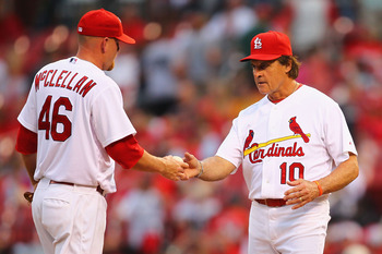 ST. LOUIS - SEPTEMBER 18: Manager Tony LaRussa #10 of the St. Louis Cardinals removes reliever Kyle McClellan #46 also of the St. Louis Cardinals from the game after McClellan gave up back-to-back home runs against the San Diego Padres at Busch Stadium on