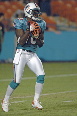 Miami Dolphins wide receiver Marcus Vick fields a kick against the St. Louis Rams August 31, 2006 at Pro Player Stadium in Miami Florida. The Dolphins won the week four pre-season game 29 - 9.  (Photo by Al Messerschmidt/Getty Images)