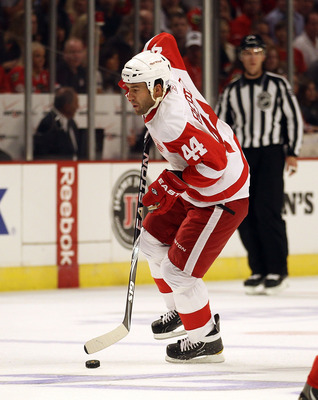 CHICAGO - OCTOBER 09: Todd Bertuzzi #44 of the Detroit Red Wings controls the puck against the Chicago Blackhawks during the Blackhawks season home opening game at the United Center on October 9, 2010 in Chicago, Illinois. The Red Wings defeated the Black