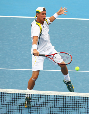 CAIRNS, AUSTRALIA - SEPTEMBER 18:  Lleyton Hewitt of Australia returns a shot during the doubles match against Olivier Rochus and Ruben Bemelmans of Belgium during day two of the Davis Cup tie between Australia and Belgium at Cairns International Tennis C