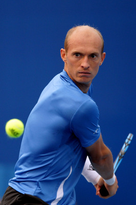 BEIJING - OCTOBER 08:  Nikolay Davydenko of Russia plays a backhand during his match against John Isner of United States  during day eight of the 2010 China Open at the National Tennis Center on October 8, 2010 in Beijing, China.  (Photo by Lintao Zhang/G