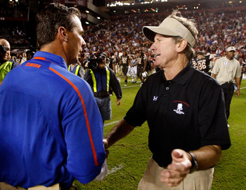 COLUMBIA, SC - NOVEMBER 14:  Head coach Urban Meyer (L) of the Florida Gators shakes hands with head coach Steve Spurrier (R) of the South Carolina Gamecocks during their game at Williams-Brice Stadium on November 14, 2009 in Columbia, South Carolina.  (P