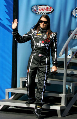 FONTANA, CA - OCTOBER 09: Danica Patrick, driver of the #7 Tissot/GoDaddy.com Chevrolet waves during driver introductions for the NASCAR Nationwide Series CampingWorld.com 300 on October 9, 2010 in Fontana, California.  (Photo by Jerry Markland/Getty Imag