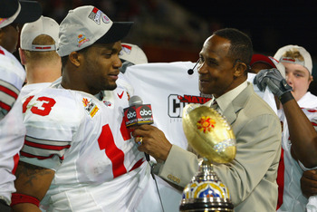 TEMPE, AZ - JANUARY 3:  Running back Maurice Clarett #13 of the Ohio State Buckeyes is interviewed by Lynn Swann after deafeating the Miami Hurricanes in the Tostitos Fiesta Bowl on January 3, 2003 at Sun Devil Stadium in Tempe, Arizona.  Ohio State won t