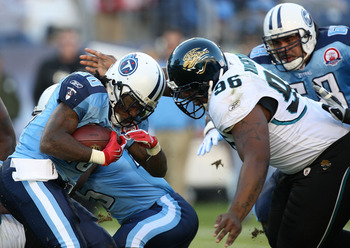 NASHVILLE, TN - NOVEMBER 01:  Terrance Knighton #96 of the Jacksonville Jaguars tries to stop Chris Johnson #28 of the Tennessee Titans during their game at LP Field on November 1, 2009 in Nashville, Tennessee.  (Photo by Streeter Lecka/Getty Images)