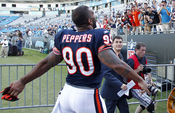 CHARLOTTE, NC - OCTOBER 10: Defensive end Julius Peppers #90 of the Chicago Bears throws his gloves into the stands as he leaves the field after the Bears game against the Carolina Panthers at Bank of America Stadium on October 10, 2010 in Charlotte, Nort