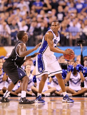 INDIANAPOLIS - APRIL 05:  Nolan Smith #2 of the Duke Blue Devils looks to pass the ball against Shelvin Mack #1 of the Butler Bulldogs during the 2010 NCAA Division I Men's Basketball National Championship game at Lucas Oil Stadium on April 5, 2010 in Ind