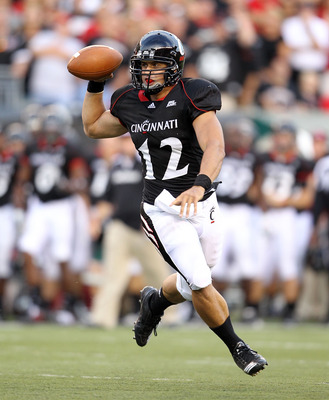 CINCINNATI - SEPTEMBER 25:  Zach Collaros #12 of  the Cincinnati Bearcats runs with the ball during the game against the Oklahoma Sooners at Paul Brown Stadium on September 25, 2010 in Cincinnati, Ohio.  (Photo by Andy Lyons/Getty Images)