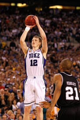 INDIANAPOLIS - APRIL 05:  Kyle Singler #12 of the Duke Blue Devils attempts a shot in the second half against the Butler Bulldogs during the 2010 NCAA Division I Men's Basketball National Championship game at Lucas Oil Stadium on April 5, 2010 in Indianap