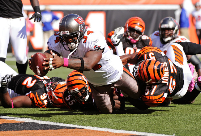CINCINNATI, OH - OCTOBER 10:  Earnest Graham #34 of the Tampa Bay Buccaneers lunges to cross the goal line for a one-yard touchdown run against the Cincinnati Bengals in the third quarter at Paul Brown Stadium on October 10, 2010 in Cincinnati, Ohio. Tamp