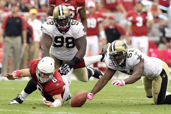 GLENDALE, AZ - OCTOBER 10:  Quarterback Max Hall #6 of the Arizona Cardinals fumbles the ball as Sedrick Ellis #98 and Jonathan Vilma #51 of the New Orleans Saints attempt to recover during the NFL game at the University of Phoenix Stadium on October 10,