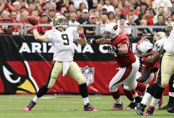 GLENDALE, AZ - OCTOBER 10:  Quarterback Drew Brees #9 of the New Orleans Saints throws a pass during the NFL game against the Arizona Cardinals at the University of Phoenix Stadium on October 10, 2010 in Glendale, Arizona. The Cardinals defeated the Saint