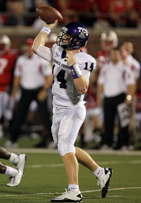 DALLAS - SEPTEMBER 24:  Quarterback Andy Dalton #14 of the TCU Horned Frogs throws a pass against the SMU Mustangs at Gerald J. Ford Stadium on September 24, 2010 in Dallas, Texas.  (Photo by Ronald Martinez/Getty Images)