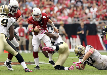 GLENDALE, AZ - OCTOBER 10:  Quarterback Max Hall #6 of the Arizona Cardinals is sacked by Jonathan Vilma ##51 of the New Orleans Saints during the second quarter of the NFL game at the University of Phoenix Stadium on October 10, 2010 in Glendale, Arizona