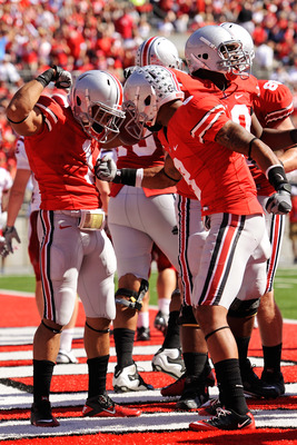 COLUMBUS, OH - OCTOBER 9:  Dan Herron #1 of the Ohio State Buckeyes celebrates his third-quarter touchdown run against the Indiana Hoosiers with teammate DeVier Posey #8 at Ohio Stadium on October 9, 2010 in Columbus, Ohio. Herron scored twice in Ohio Sta