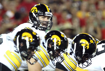 TUCSON, AZ - SEPTEMBER 18:  Quarterback Ricky Stanzi #12 of the Iowa Hawkeyes prepares to snap the ball during the college football game against the Arizona Wildcats at Arizona Stadium on September 18, 2010 in Tucson, Arizona.  The Wildcats defeated the H