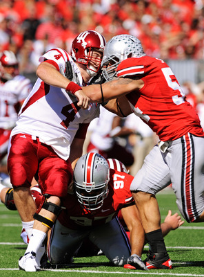 COLUMBUS, OH - OCTOBER 9:  Quarterback Ben Chappell #4 of the Indiana Hoosiers is hit just after releasing the ball by John Simon #54 and Cameron Heyward #97 of the Ohio State Buckeyes at Ohio Stadium on October 9, 2010 in Columbus, Ohio.  (Photo by Jamie