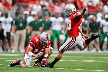 COLUMBUS, OH - SEPTEMBER 2: Devin Barclay #23 of the Ohio State Buckeyes kicks an extra point against the Marshall Thundering Herd at Ohio Stadium on September 2, 2010 in Columbus, Ohio. (Photo by Jamie Sabau/Getty Images)
