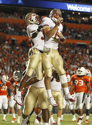 MIAMI, FL - OCTOBER 9: Jermaine Thomas #38 (L) celebrates his touchdown with Christian Ponder #7 (R) of the Florida State Seminoles against the Miami Hurricanes on October 9, 2010 at Sun Life Stadium in Miami, Florida. (Photo by Joel Auerbach/Getty Images