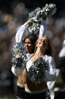 OAKLAND, CA - OCTOBER 10:  Oakland Raiders cheerleaders, the Raiderettes, cheer for their team during their game against the San Diego Chargers at Oakland-Alameda County Coliseum on October 10, 2010 in Oakland, California.  (Photo by Ezra Shaw/Getty Image