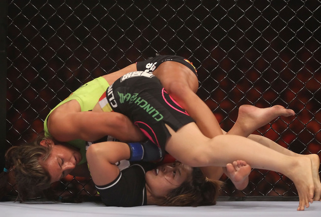 PHOENIX - AUGUST 13:  Miesha Tate (top) battles with Hitomi Akano of Japan in the Strikeforce Women's Welterweight Tournament Championship bout at Dodge Theater on August 13, 2010 in Phoenix, Arizona.  (Photo by Christian Petersen/Getty Images)