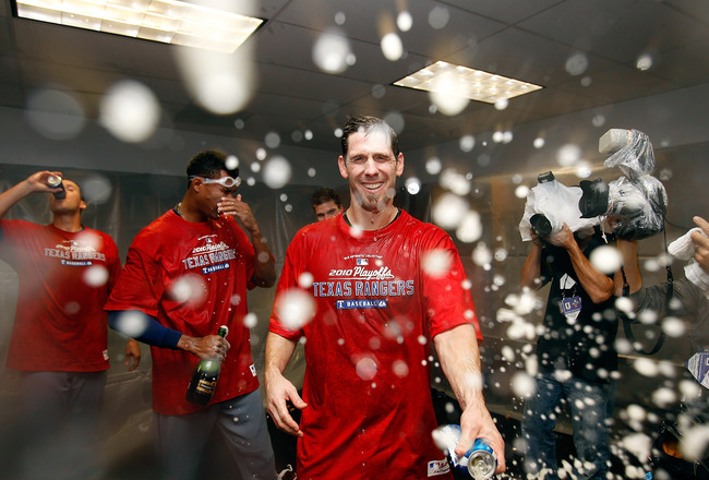 ST PETERSBURG, FL - OCTOBER 12:  :  Pitcher Cliff Lee #33 of the Texas Rangers celebrates his team's victory over the Tampa Bay Rays in Game 5 of the ALDS at Tropicana Field on October 12, 2010 in St. Petersburg, Florida.  (Photo by J. Meric/Getty Images)