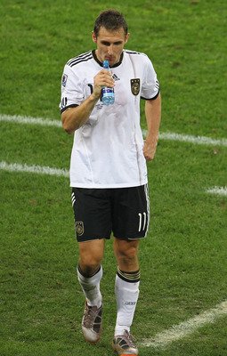 DURBAN, SOUTH AFRICA - JULY 07:  Miroslav Klose of Germany leaves the field dejected after being knocked out of the competition following the 2010 FIFA World Cup South Africa Semi Final match between Germany and Spain at Durban Stadium on July 7, 2010 in