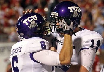 DALLAS - SEPTEMBER 24:  Wide receiver Bart Johnson #6 of the TCU Horned Frogs celebrates a touchdown with Andy Dalton #14 in the third quarter against the SMU Mustangs at Gerald J. Ford Stadium on September 24, 2010 in Dallas, Texas.  (Photo by Ronald Mar