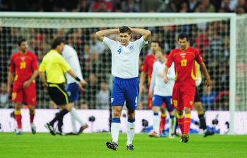 LONDON, ENGLAND - OCTOBER 12:  Steven Gerrard of England shows his frustration during the UEFA EURO 2012 Group G Qualifying match between England and Montenegro at Wembley Stadium on October 12, 2010 in London, England.  (Photo by Shaun Botterill/Getty Im