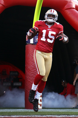 SAN FRANCISCO - SEPTEMBER 20:  Michael Crabtree #15 of the San Francisco 49ers runs on to the field for their game against the New Orleans Saints at Candlestick Park on September 20, 2010 in San Francisco, California.  (Photo by Ezra Shaw/Getty Images)