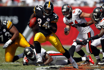 TAMPA, FL - SEPTEMBER 26:  Running back Rashard Mendenhall #34 of the Pittsburgh Steelers runs the ball against the Tampa Bay Buccaneers during the game at Raymond James Stadium on September 26, 2010 in Tampa, Florida. The undefeated Steelers won 38-13.