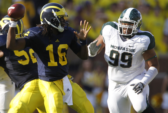 ANN ARBOR, MI - OCTOBER 09: Jerel Worthy #99 of the Michigan State Spartans rushes Denard Robinson #16 of the Michigan Wolverines during the game on October 9, 2010 at Michigan Stadium in Ann Arbor, Michigan. (Photo by Leon Halip/Getty Images)