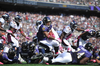BALTIMORE, MD - OCTOBER 10:  Ray Rice #27 of the Baltimore Ravens scores a touchdown against the Denver Broncos at M&T Bank Stadium on October 10, 2010 in Baltimore, Maryland. Players wore pink in recognition of Breast Cancer Awareness Month. The Ravens d