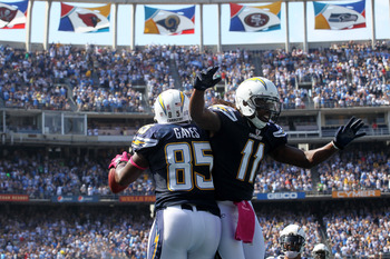 SAN DIEGO - OCTOBER 03:  Tight end Antonio Gates #85 and wide receiver Legedu Naanee #11 of the San Diego Chargers celebrate after a Gates touchdown reception against the Arizona Cardinals at Qualcomm Stadium on October 3, 2010 in San Diego, California.