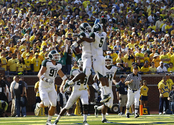ANN ARBOR, MI - OCTOBER 09:  Chris Rucker #29 of the Michigan State Spartans celebrate with his teammates after intercepting Denard Robinson #16 of the Michigan Wolverines during the fourth quarter of the game on October 9, 2010 at Michigan Stadium in Ann