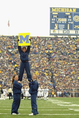 ANN ARBOR, MI - OCTOBER 25:  Cheerleaders support the University of Michigan Wolverines during the NFL game against the Purdue University Boilermakers at Michigan Stadium on October 25, 2003 in Ann Arbor, Michigan. Michigan won 31-3. (Photo by Danny Molos
