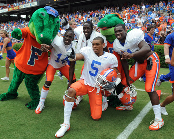 GAINESVILLE, FL - APRIL 18: Cornerback Joe Haden #5 of the University of Florida poses with two Gator mascots after the spring football orange and blue game April 18, 2009 at Ben Hill Griffin Stadium in Gainesville, Florida.  (Photo by Al Messerschmidt/Ge