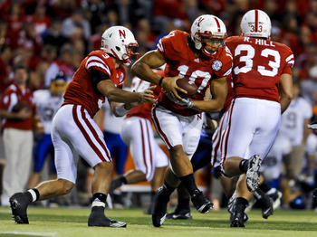 LINCOLN, NEBRASKA - SEPTEMBER 25: Nebraska Cornhuskers quarterback Taylor Martinez #3 hands the ball to running back Roy Helu Jr. #10 during second half action of their game at Memorial Stadium on September 25, 2010 in Lincoln, Nebraska. Nebraska Defeated