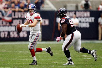 HOUSTON - OCTOBER 10:  Eli Manning #10 of the New York Giants in action during the game against the Houston Texans at Reliant Stadium on October 10, 2010 in Houston, Texas.  (Photo by Chris Graythen/Getty Images)